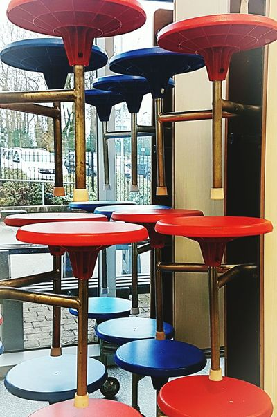 Red Lifestyles Chair Modern Indoors  No People Tables And Chairs Shapes And Patterns  Circle Shapes And Curves See What I See Seeing The World Differently Shapes And Patterns  Symmetry Lines And Curves Blue Waiting To Be Sat Upon