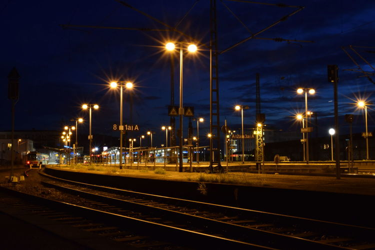 Architecture Building Exterior Built Structure City Electricity  Illuminated Light Lighting Equipment Mode Of Transportation Nature Night No People Outdoors Rail Transportation Railroad Station Railroad Track Sky Street Street Light Track Train Train Station Transportation