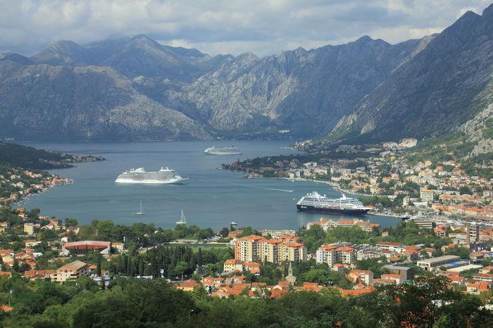 The view of the Bay of Kotor or Boka Kotorska in Montenegro. Bay Of Kotor Boka Kotorska Cruise Ship Travel Adriatic Coast Architecture Bay High Angle View Montenegro Mountain Mountain Range Scenery Scenics Sea Tourism Town Travel Destinations