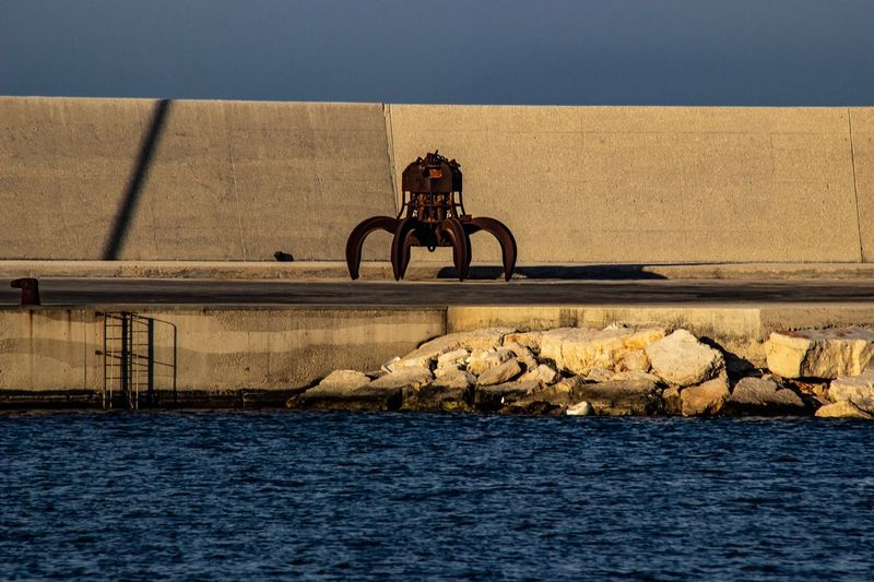 A rusty spider Port Of Monopoli Sea And Sky Rusty Metal Industrial Harbour Transportation Water Mode Of Transportation Waterfront Sea Outdoors