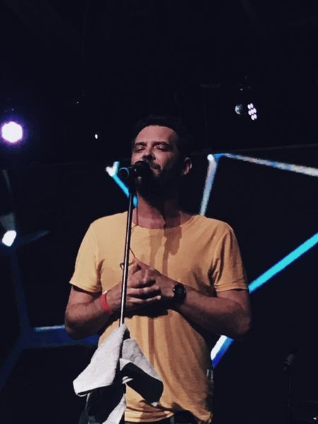 Performance Real People Music One Person Microphone Lifestyles Leisure Activity Arts Culture And Entertainment Front View Musician Standing Stage - Performance Space Beard Holding Casual Clothing Playing Performing Arts Event Mature Men Musical Instrument Illuminated PunnanyMassif