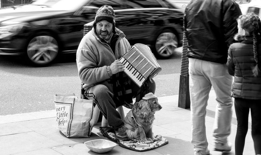 Accordion Adult Beggar Begging Black And White Bowl City Day Dog Girl Music Outdoors People Player Sitting Social Issues Street Street Performer Traffic EyeEm LOST IN London Pet Portraits Black And White Friday Perspectives On People