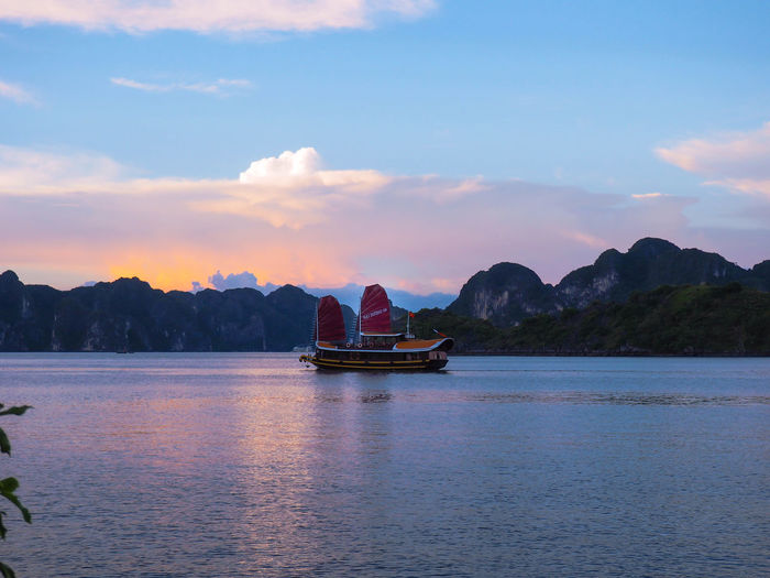 Halong Bay Vietnam Lost In The Landscape Vietnam Beauty In Nature Boat Landscape Mountain Range Nautical Vessel Outdoors Purple Sunset Tranquility Travel Destinations Water