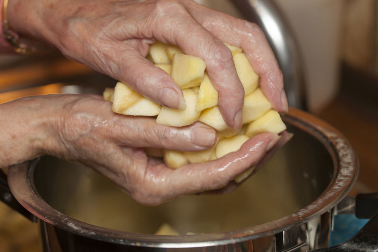 Close-up of hand holding potatoes
