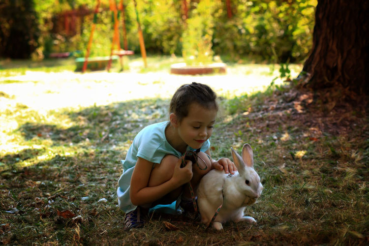 Girl With Rabbit On Field