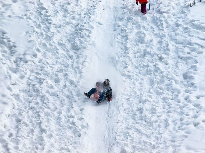 High angle view of woman skiing on snow covered field