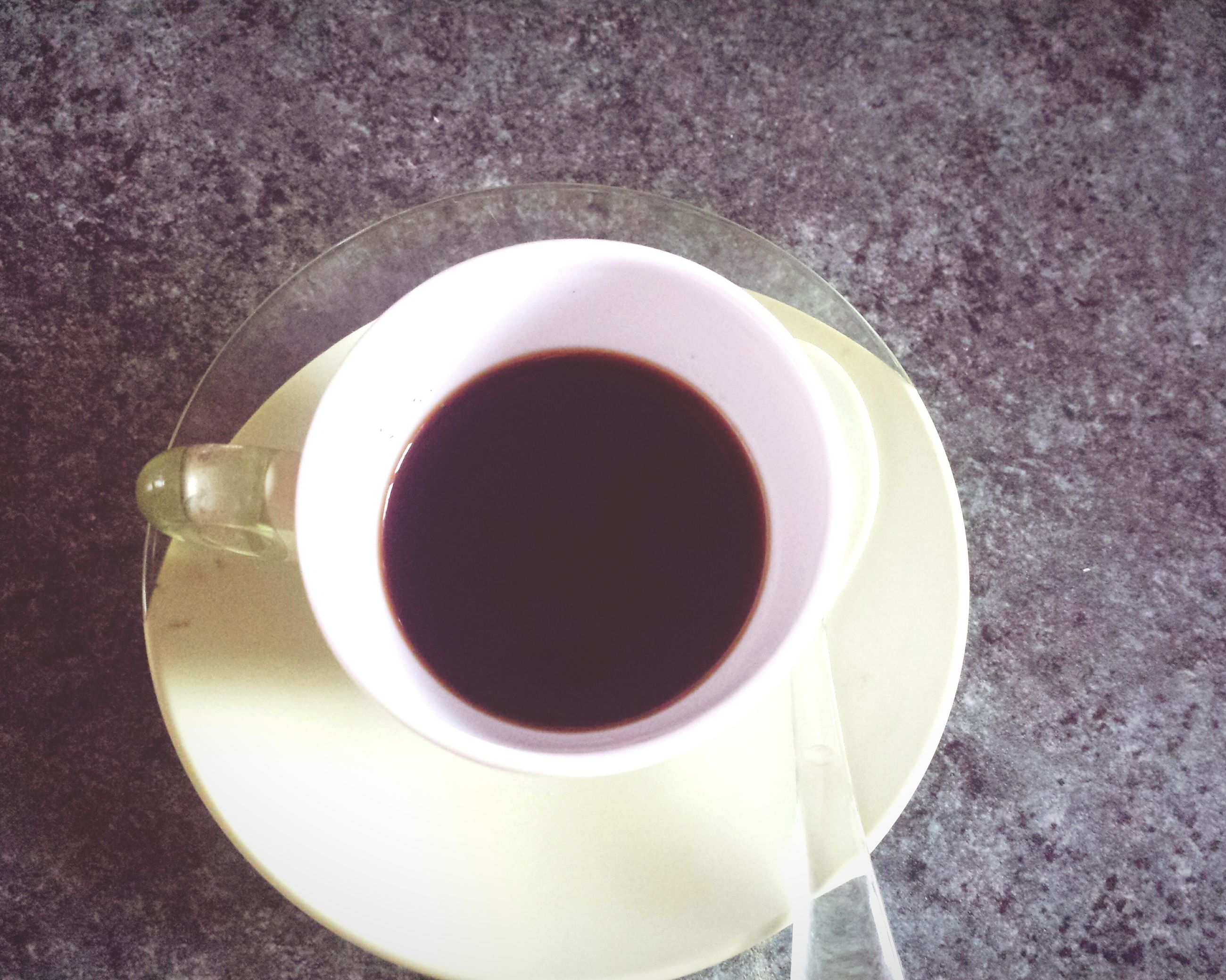 coffee cup, food and drink, drink, indoors, refreshment, coffee - drink, saucer, freshness, table, cup, high angle view, directly above, still life, coffee, spoon, overhead view, tea cup, tea, close-up, healthy eating