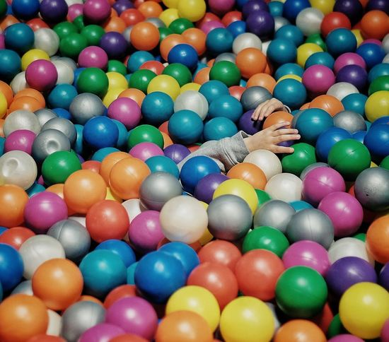 Multi Colored Large Group Of Objects Abundance Human Body Part Indoors  Leisure Activity Ball Playing Fun Boys Child Human Hand Pool Ball One Person