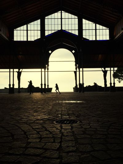Silhouette people in city