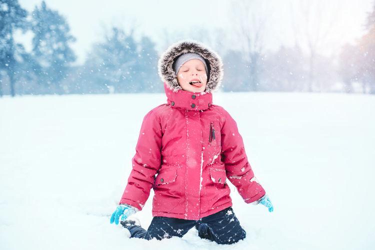 Full length of a girl in snow