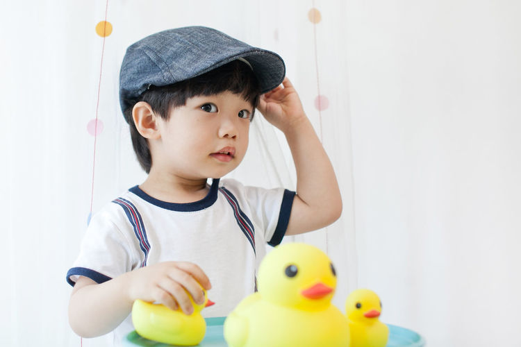 Cute Boy Playing With Rubber Ducks