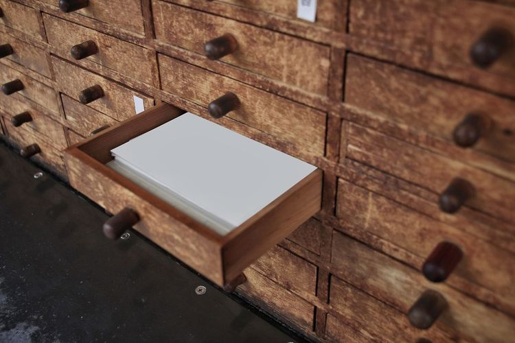 High angle view of documents in open drawer