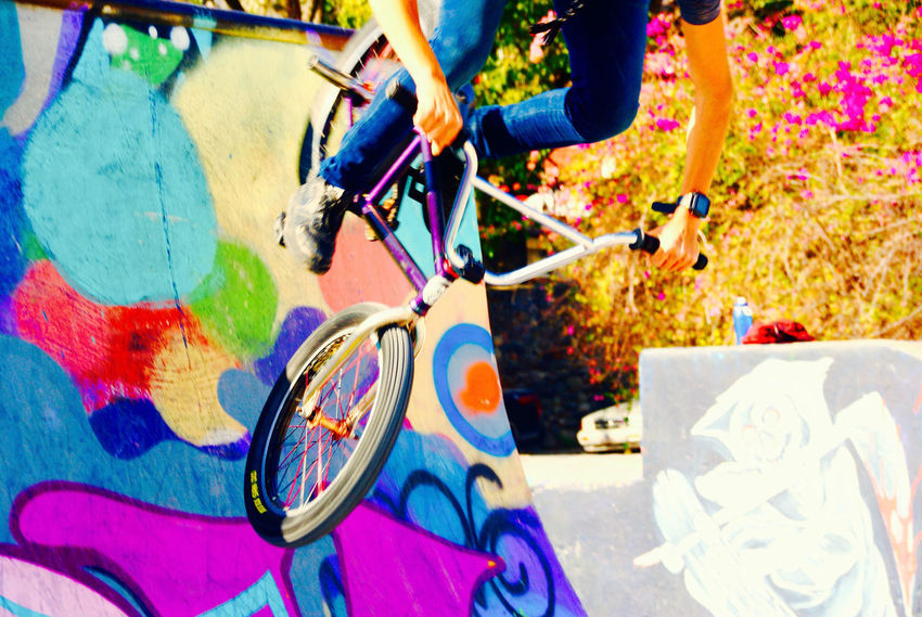 Graffiti Arts Culture And Entertainment Bicycle Blue Close-up Day Graffiti Wall Human Body Part Human Leg Leisure Activity Lifestyles Low Section Motion Multi Colored One Person Outdoors People Real People Skateboard Park Skill  Youth Culture Stories From The City