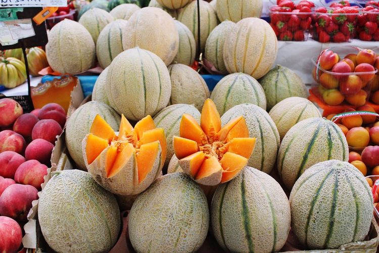 Cantaloupes for sale at market stall
