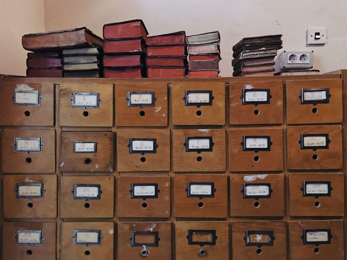 Organized chaos... Box - Container Drawer Stack Filing Cabinet Full Frame In A Row Bookshelf Library Data Archives Large Group Of Objects Books Furnitures Wood Brown Vintage Organized Shelf Interior Design Neat Business Stack Cabinet Education Abundance