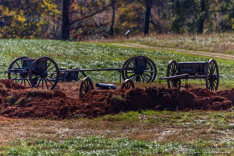 Cannon & Carriages Abandoned Absence Broken Cannon, Carriages  Damaged Day Field Grass Land Vehicle Metal Obsolete Old Outdoors Remote Rusty Side View Sitting Wheel Wood
