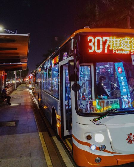 Illuminated Mode Of Transportation Text Transportation Night Public Transportation Incidental People City Architecture Western Script Land Vehicle Glass - Material Communication Outdoors Street Transparent Built Structure Motion Bus Taiwan