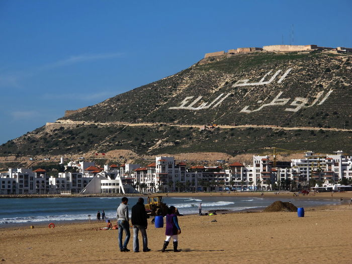 Agadir memorial Adult Adults Only Agadir Earthquake Agadir Memorial Architecture Beach Building Exterior Day Large Group Of People Nature Outdoors People Real People Sea Sky Water