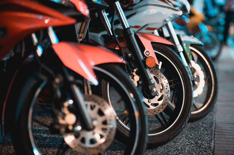 Close-up of toy motorcycles on street