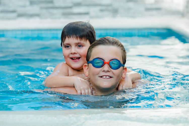 Close-up of boys swimming in pool