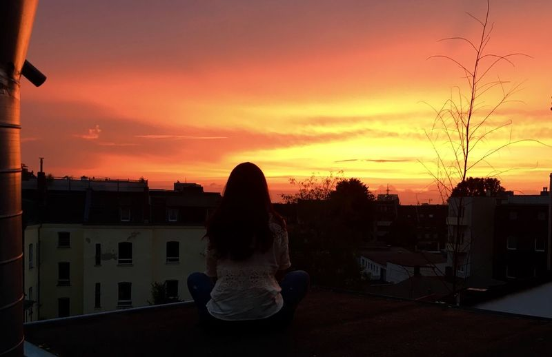 Cologne , Köln,  Summer Rooftop Above The Roofs Redorangeyellow Sunset Building Exterior Architecture Built Structure Silhouette Sky One Person Outdoors Beauty In Nature Nature Sitting City One Woman Only Day
