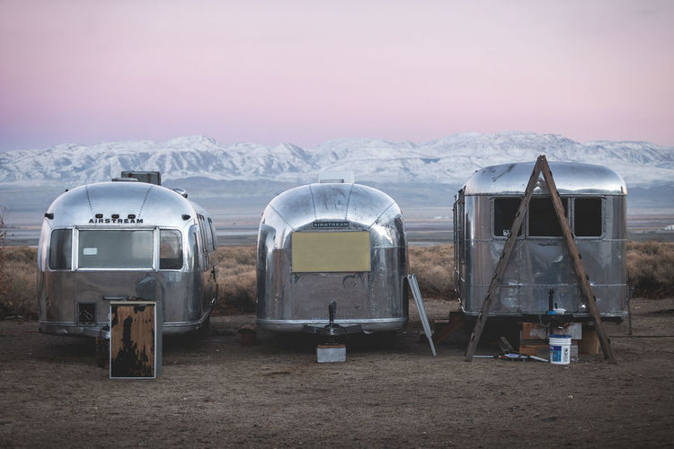 Vintage Airstream and Spartan trailers. Sky Mountain Nature Winter Beauty In Nature Scenics - Nature Snow Mode Of Transportation Environment Landscape No People Cold Temperature Transportation Travel Outdoors Tranquility Field Day Tranquil Scene Snowcapped Mountain Airstream Vintage Classic