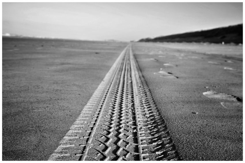 Tire Track Beach Sand Sandy Beach Blackandwhite Blackandwhite Photography Blackandwhitephotography Blackandwhitephoto Black And White Black And White Photography EyeEm Best Shots - Black + White Bandw Texel, The Netherlands Texel  Straight Tire Track Diminishing Perspective Sky Landscape Grass Track