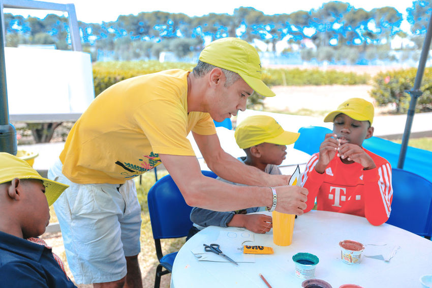 African children learn handicrafts Chapeau De Soleil Painted Dye Scissors African Children Boys Cap Casual Clothing Child Childhood Group Of People Handicrafts Leisure Activity Lifestyles Males  Men People Real People Sitting Sun Hat Table