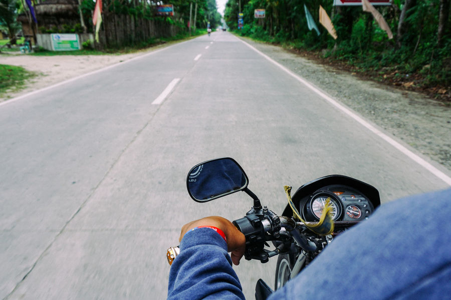 Riding through the tropic roads Backpacking Forward Holiday Motorcycle Philippines Travel Travel Photography Traveling Trip Close-up Day Journey Lifestyles Mindanao One Person Personal Perspective Real People Ride The Way Forward Transportation Tropical Vacation The Week On EyeEm