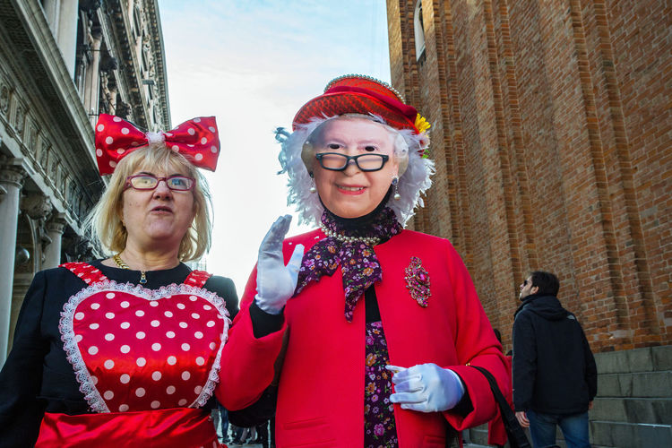 Carnival Carnival In Venice Venice, Italy Architecture Building Exterior Carnival Costumes Day Front View Happiness Leisure Activity Lifestyles Looking At Camera Mask Outdoors People Portrait Real People Red Smiling Standing Togetherness Two People Young Adult Young Women