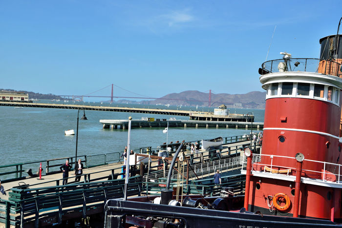 Hyde Street Pier 12 San Francisco CA🇺🇸 Hyde St. Pier Waterfront♥ San Francisco Maritime National Historic Park Historic Steamer The Hercules Moored Pier Dock Harbor San Francisco Bay Golden Gate Bridge Tide Barrier Marin Headlands People On The Wharf Boat Ramp Warehouse Sailboats Sailing Bridge Towers & Span Bridge Arch Fort Point Lime Point Tourist Attraction  A Day On The Bay Blue Skies