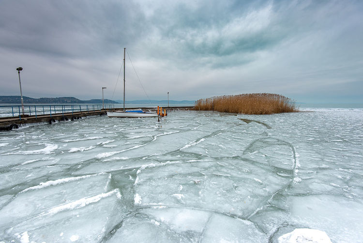 Frozen sea against sky during winter