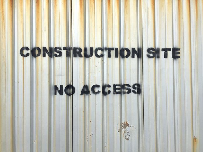 Warning sign on corrugated iron