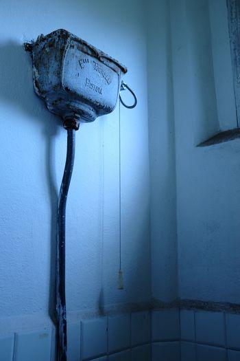 Flush tank in abandoned bathroom