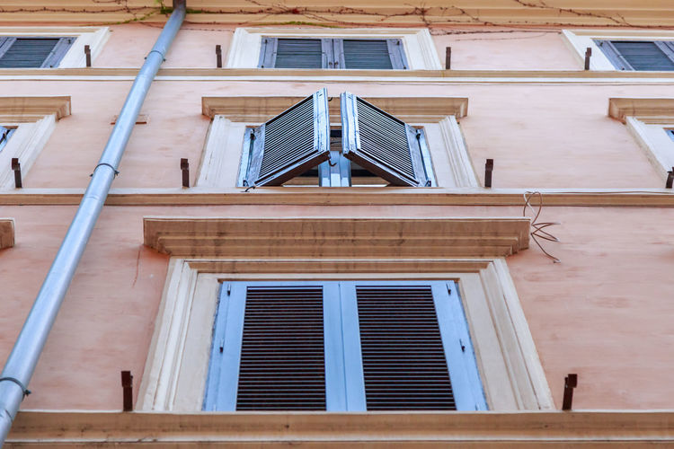 facade of a building in Rome with open shutters on windows Façade Open Shutters Roma Urban Exploration Architecture Bottom View Building Exterior Built Structure Day Facade Building Facades Italy Low Angle View No People Outdoors Urban Window Moving Around Rome