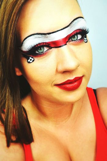 Close-Up Portrait Of Female Soccer Fan With Polish Flag Face Paint