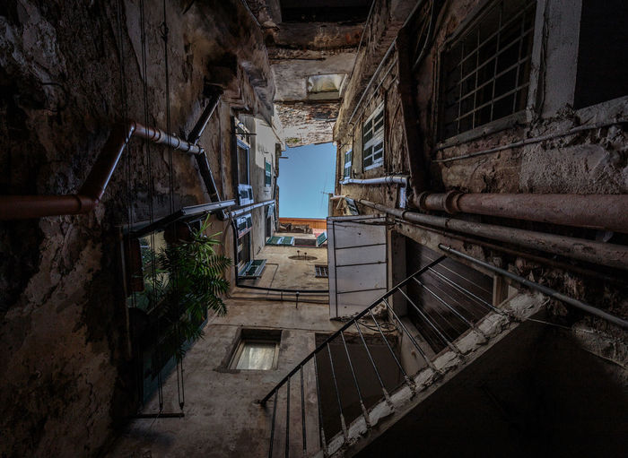 Abandoned Architecture Building Exterior Built Structure Damaged Day House No People Outdoors Railing Residential Building Run-down Staircase Steps Steps And Staircases