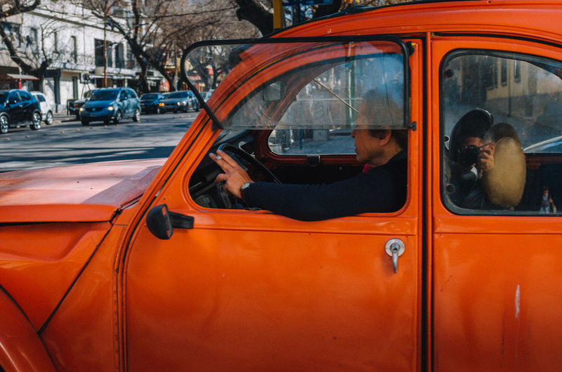 Citroen 2CV Mode Of Transportation Transportation Car Land Vehicle City Motor Vehicle Street Architecture Day Men Orange Color Taxi Real People Outdoors Travel People Window Glass - Material City Street Adult EyeEm Best Shots EyeEm Selects Citroen 2cv The Street Photographer - 2019 EyeEm Awards