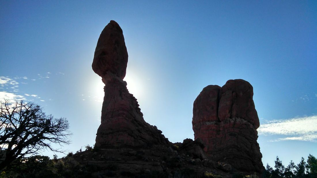 #arches #nationalpark #redrock #Utah Beauty In Nature Blue Clear Sky Cliff Copy Space Eroded Geology Landscape Low Angle View Nature Non-urban Scene Outdoors Rock Rock - Object Rock Formation Rough Scenics Sky Tranquil Scene Tranquility Tree
