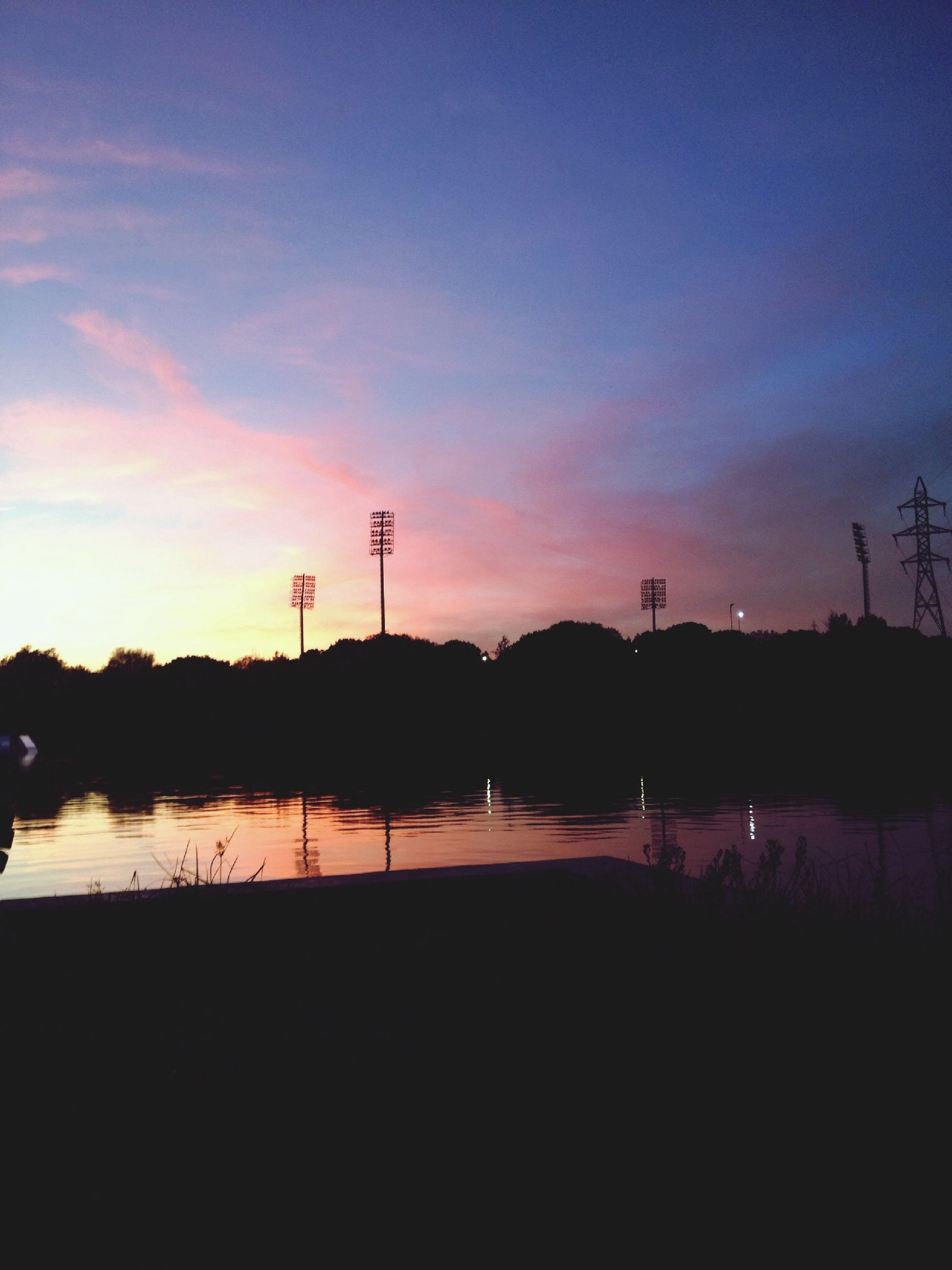 sunset, silhouette, sky, tranquil scene, scenics, tranquility, water, beauty in nature, orange color, tree, nature, lake, idyllic, dusk, reflection, cloud - sky, outdoors, calm, river, landscape