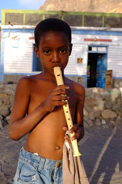 Child Playing Standing Childhood One Person Focus On Foreground Musical Instrument Cultures Day Portrait People Outdoors Shirtless