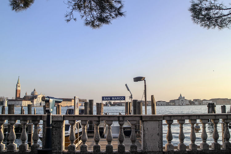 Mid distance view of san giorgio maggiore church by grand canal against clear sky