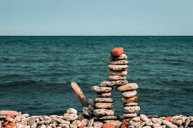 Is That An Inukshuk, Or Are You Just Happy To See Me? [FS] Check This Out Exceptional Photographs Hanging Out Hello World Inukshuk Nature Pebble Beach Relaxing Taking Photos Tranquility Canada Coast To Coast Day Enjoying Life First Eyeem Photo Horizon Over Water Landscape No People Outdoors Sea Sentry Sky Stack Rock Stone Water Wood