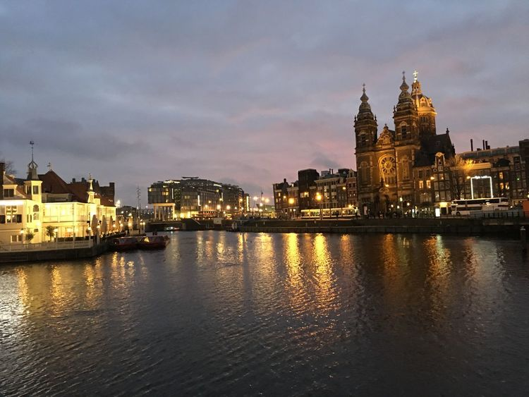Amsterdam Amsterdamcity Architecture Beautiful Building Exterior Church City City Citylife Dusk Holland Iamamsterdam Illuminated Netherlands Niederlande Night Place Of Worship Reflection River Sky Sunset Water Waterfront
