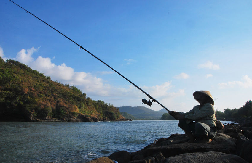 Man Nature Photography River View Silhouettes Beauty In Nature Blue Sky And Clouds Clouds Clouds And Sky Fisher Man Fisherman Fishing Fishing Boat Fishing Pole Fishing Rod Fishing Tackle Fishing Time Hill Holding Indonesian Man Leisure Activity Nature Naturelovers One Person Sea Sky First Eyeem Photo