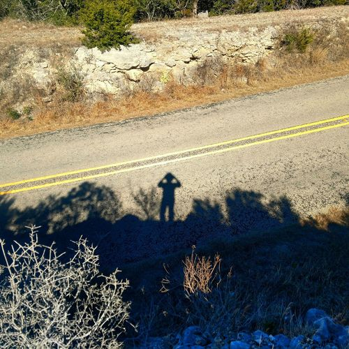 My shadow taking a selfie. Stickfigure Light And Shadow Light And Shadows Roadsidephotography Roadside America Shadows On The Wall Selfıe Selfies Self Portrait Selfportrait Hills And Valleys Hilltop Hilltop View Looking Down Lookingdown Road Roadside Shadow Sunlight High Angle View Men Focus On Shadow Long Shadow - Shadow Silhouette