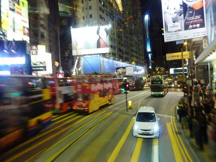 City Transportation Illuminated Car Street Night Building Exterior City Life City Street Land Vehicle Mode Of Transport Architecture Road Built Structure Outdoors Motion No People Travel Travel Destinations Hong Kong Nightlife Nightphotography City Never Sleeps