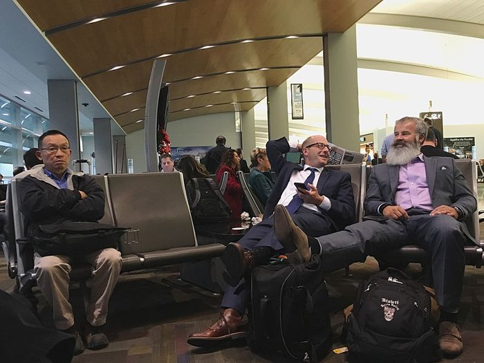 Waiting Game Laptop Sitting Technology Wireless Technology Business Using Laptop Group Of People Computer Full Length Large Group Of People Men Indoors  People Illuminated Businessman Adults Only Adult Airport Senior Men Togetherness