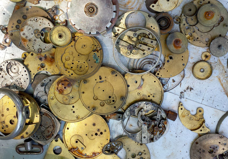watch parts inside out; gears and tiny dials, innards of watches from the past Antique Retro Clock Close-up Day Gear Indoors  Large Group Of Objects Lots Of Parts Machine Part Metal Movements No People Old Silver  Variation Vintage Watch Parts