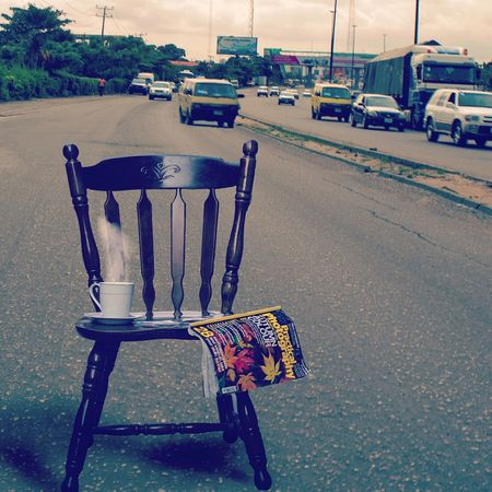 Calm in the lagos chaos Nigeria Lagos Calm Chair Street Car Road Outdoors Day No People EyeEm Ready   EyeEm Ready